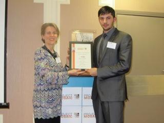Timur Ahmet accepts Runner Up Award